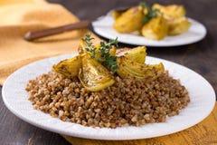 Buckwheat porridge with baked onions Royalty Free Stock Image