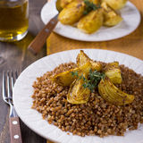 Buckwheat porridge with baked onions Stock Photography