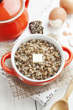 Buckwheat porridge with butter and eggs Royalty Free Stock Photos