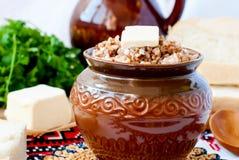 Buckwheat porridge with butter Stock Images
