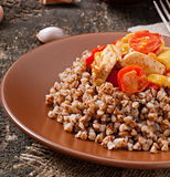 Buckwheat porridge with chicken and vegetables Royalty Free Stock Photography