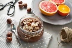 Buckwheat porridge with cocoa, hazelnuts and banana Stock Photos