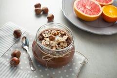 Buckwheat porridge with cocoa, hazelnuts and banana Stock Photo