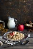 Buckwheat porridge with milk, apple, raisins and cashew nuts. Buckwheat porridge with apples, raisins and cashew nuts for breakfast stock photo