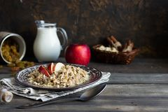 Buckwheat porridge with milk, apple, raisins and cashew nuts. Buckwheat porridge with apples, raisins and cashew nuts for breakfast royalty free stock photos