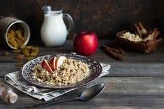 Buckwheat porridge with milk, apple, raisins and cashew nuts. Buckwheat porridge with apples, raisins and cashew nuts for breakfast stock images