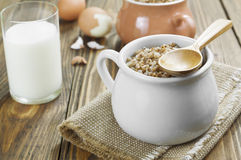 Buckwheat porridge, milk and eggs Royalty Free Stock Image
