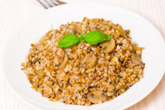 Buckwheat porridge with mushrooms Stock Photography