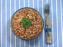 Buckwheat porridge with parsley in glass bowl Royalty Free Stock Photography