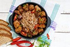 Buckwheat porridge with pieces of fried pork Stock Photography