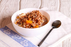 Buckwheat porridge with pumpkin, banana and Apple Stock Photography