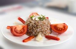 Buckwheat Porridge or Russian Kasha on White Plate. Exquisite Serving Buckwheat Porridge on White Plate. Russian Kasha or Cooked Pseudocereal Buck Wheat stock photos