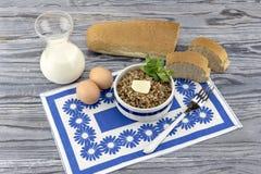 Buckwheat porridge on the table Stock Photo