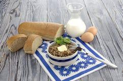 Buckwheat porridge on the table Stock Image