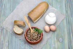 Buckwheat porridge on the table Stock Images