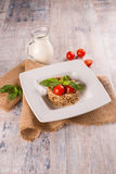 Buckwheat porridge on a table in the decor Stock Photo