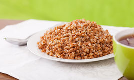 Buckwheat porridge with tea Stock Image