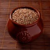 Buckwheat in a pot. Buckwheat in a clay pot. Close-up Royalty Free Stock Photos