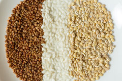 Buckwheat, rice, and oatmeal grains Royalty Free Stock Image