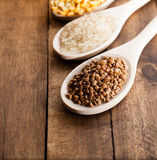 Buckwheat, rice and peas. Neatly piled in wooden spoons, which lie on a napkin Stock Image