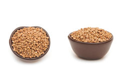 Buckwheat in round brown cup Royalty Free Stock Image