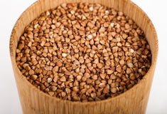 Buckwheat in a round wooden bank. Cute buckwheat in a round wooden bank Stock Image