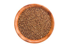 Buckwheat in round wooden plate. Stock Photography
