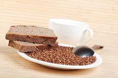 Buckwheat and rye bread on plate Royalty Free Stock Images