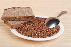 Buckwheat and rye bread on plate Stock Photo