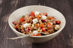 Buckwheat salad with roasted peppers and feta royalty free stock images