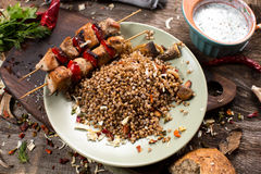 Buckwheat with sauce and chicken kebabs Royalty Free Stock Photo