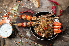 Buckwheat with sauce and chicken kebabs Stock Photography