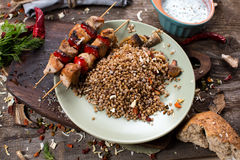 Buckwheat with sauce and chicken kebabs Stock Photos