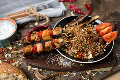 Buckwheat with sauce and chicken kebabs Stock Images