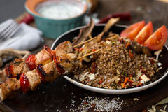 Buckwheat with sauce and chicken kebabs Stock Photo