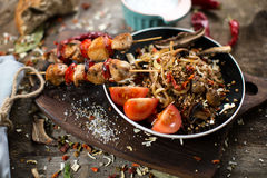 Buckwheat with sauce and chicken kebabs Royalty Free Stock Photos