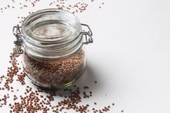 Buckwheat is scattered on the table. Healthy wholesome food. Buc. Buckwheat is scattered on a wooden table Stock Photo
