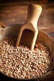 Buckwheat in scoop and bowl on wooden table Royalty Free Stock Images