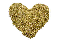 Buckwheat seeds forming a heart Stock Images