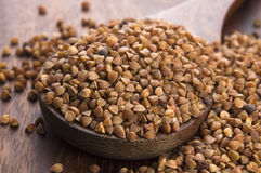 Buckwheat seeds on wooden spoon Royalty Free Stock Photography