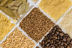 Buckwheat in set of groceries. With bay leafs, vermicelli, rice, roasted coffee beans, dried peas, figured macaroni Royalty Free Stock Photos