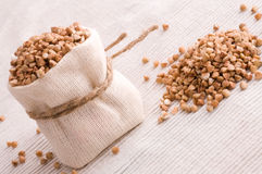 Buckwheat in small sack Royalty Free Stock Image