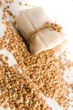 Buckwheat in small sack Stock Image