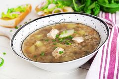 Buckwheat Soup With Chicken In A Plate, Bread With Mustard Ang Red Onion Royalty Free Stock Images