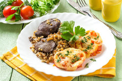 Buckwheat with stewed chicken liver and tomatoes baked with chee Royalty Free Stock Photography