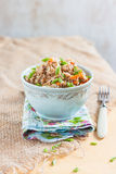 Buckwheat, stewed with meat, carrots and onions on a light background Royalty Free Stock Images