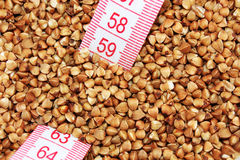 Buckwheat with tape measure Stock Photography