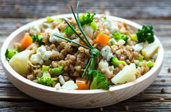 Buckwheat with  vegetables and feta cheese Royalty Free Stock Images