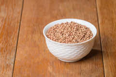 Buckwheat in white bowl Royalty Free Stock Photos