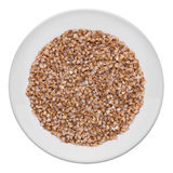 Buckwheat on a white plate Royalty Free Stock Photo